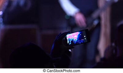 Shoots stage and silhouettes of people by phone 4k - Shoots...
