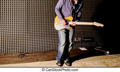 Guy Plays Guitar at Rehearsal in Studio at Bright Light -...