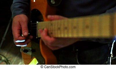 Closeup Guy Plays Guitar at Rehearsal in Studio - closeup...
