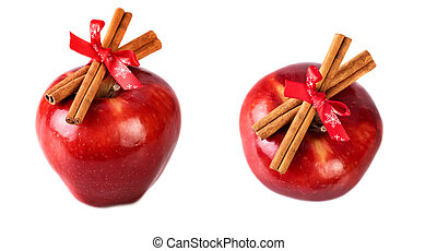 Bright red apples christmas decorated with cinnamon sticks...