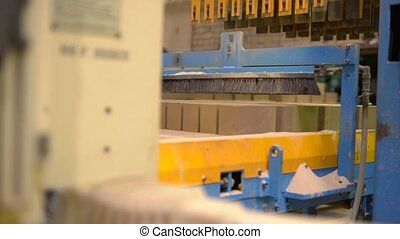 View of equipment in brick manufacturing shop - View of...