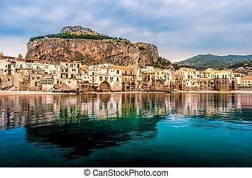 View on habour and old houses in Cefalu at night, Sicily -...