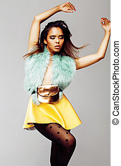 young pretty african-american woman posing in fashion...