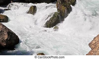 Fast water flow. Tazhikistan. Iskanderdarya