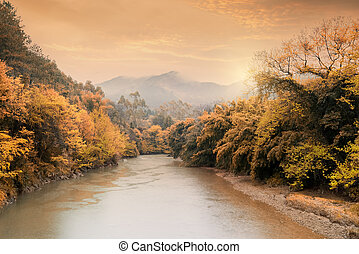 Colorful autumn landscape in the mountains with river