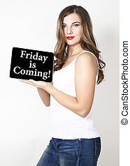 friday is coming written on virtual screen. technology,...