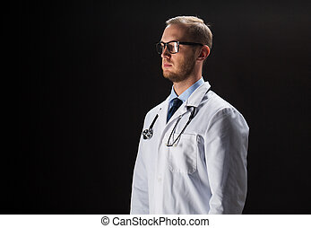 doctor in white coat with stethoscope - healthcare, people,...