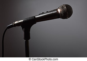 Microphone in the dark with gray background - Microphone on...