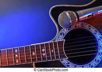 Acoustic guitar and microphone isolated with red and blue...