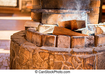 Firewoods burn in hearth - Firewoods burn in oven made of...