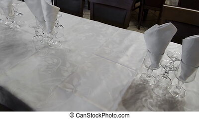 Table Set With Glasses And Tablecloth - Empty table set with...