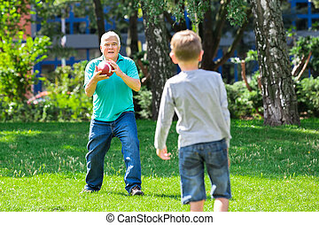 Grandson And Grandfather Playing Rugby