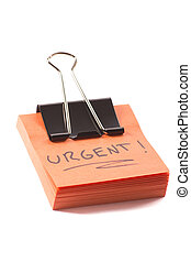 post-it note with clip and message urgent on white background