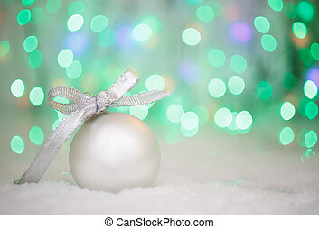 christmas ball on abstract light background, place for text