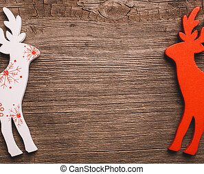 Two Christmas Reindeer on wooden background