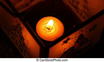 Christmas lantern with candle shining in the darkness,...