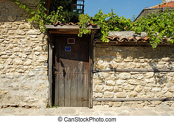 Door on street in old town of Nesebar, Bulgaria