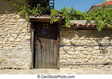 Door on street in old town of Nesebar, Bulgaria