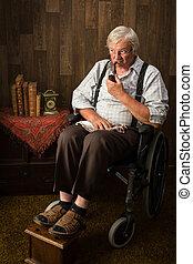 Elderly man in wheelchair
