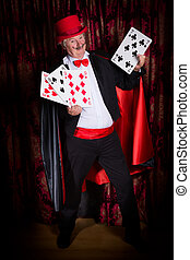 Happy magician with cards