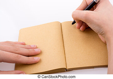 Hand writing on notebook - Hand writing on an empty notebook...