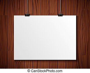 white paper hanging on wooden background.