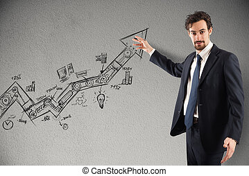 Business statistics uphill - Businessman draws and shows...