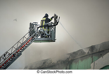 Firefighters in action fighting fire