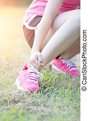sport woman ankle injury