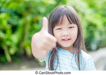 girl smile happily in park - little girl smile happily and...