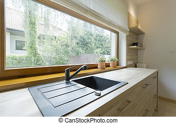 Bright kitchen with panoramic view of the neighbourhood