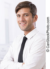 Employee of a month - Close portrait of handsome and smiled...