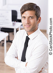 Confident smiling man with folded arms - Work office...