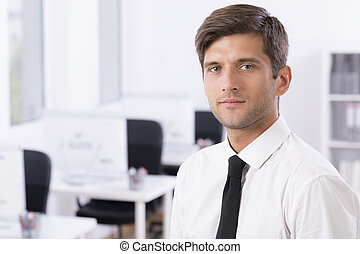 Man in white shirt and tie in office - Earnest, elegant man...