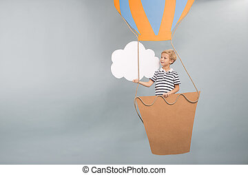 Child playing with paper balloon - Creative child playing...