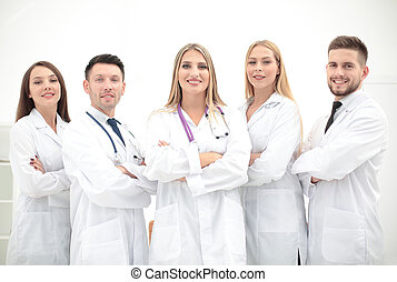 Portrait of group of smiling hospital colleagues standing...