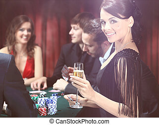 Young people have a good time in casino - Poker players...