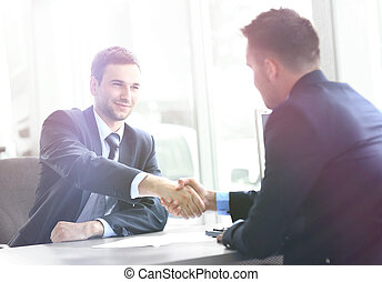 businessman shaking hands in office - businessman shaking...