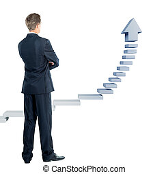 Young businessman looking at a ladder
