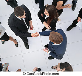 Elevated view of large group of multiethnic business people...