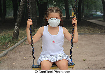 The girl in a respirator - The girl in a breathing mask on a...