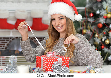 Woman with Christmas present - Portrait of happy young woman...