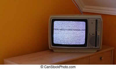 TV no signal - No signal just noise on a small TV in a dim...