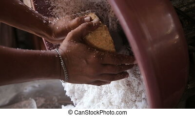 woman extraction of coconut pulp - Woman on a public market...