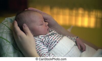 Sleeping Newborn Baby Smiling - Mother At Home With Sleeping...