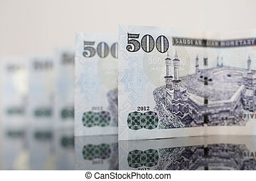 Saudi Notes reflected on a dark glass - Saudi Riyal is the...