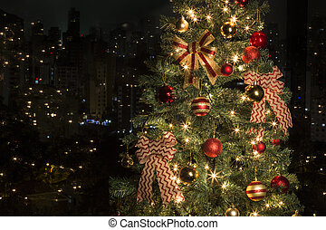 Christmas in the city - Christmas tree with lights on, in...