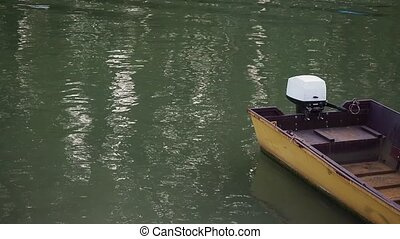 The yellow fishing boat with outboard motor. - Picture of...