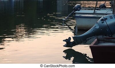 Background of the blue fishing boat with outboard motor. -...