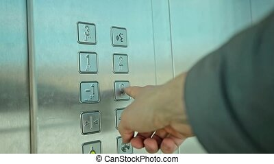 Man Hand Pressing Button Zero Inside Elevator.